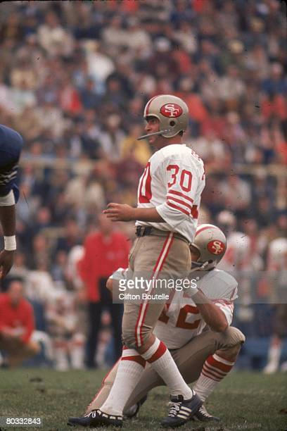 Kicker Bruce Gossett of the San Francisco 49ers kicks a field goal on the hold of quarterback John Brodie in an NFL game against the Buffalo Bills at...