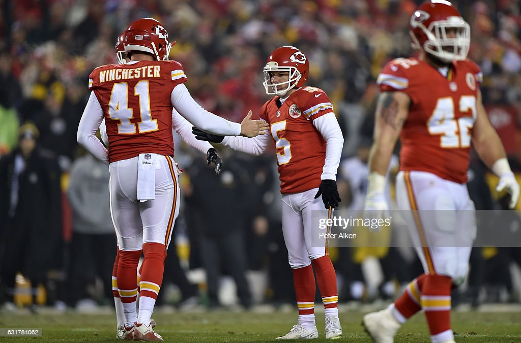 Kicker Cairo Santos #5 of the Kansas City Chiefs high fives teammate James Winchester #41 after a successful field goal against the Pittsburgh Steelers in the second half in the AFC Divisional Playoff game at Arrowhead Stadium on January 15, 2017 in Kansas City, Missouri.