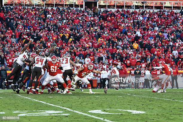 Kicker Cairo Santos of the Kansas City Chiefs kicks an extra point over the diving cornerback Ryan Smith of the Tampa Bay Buccaneers at Arrowhead...