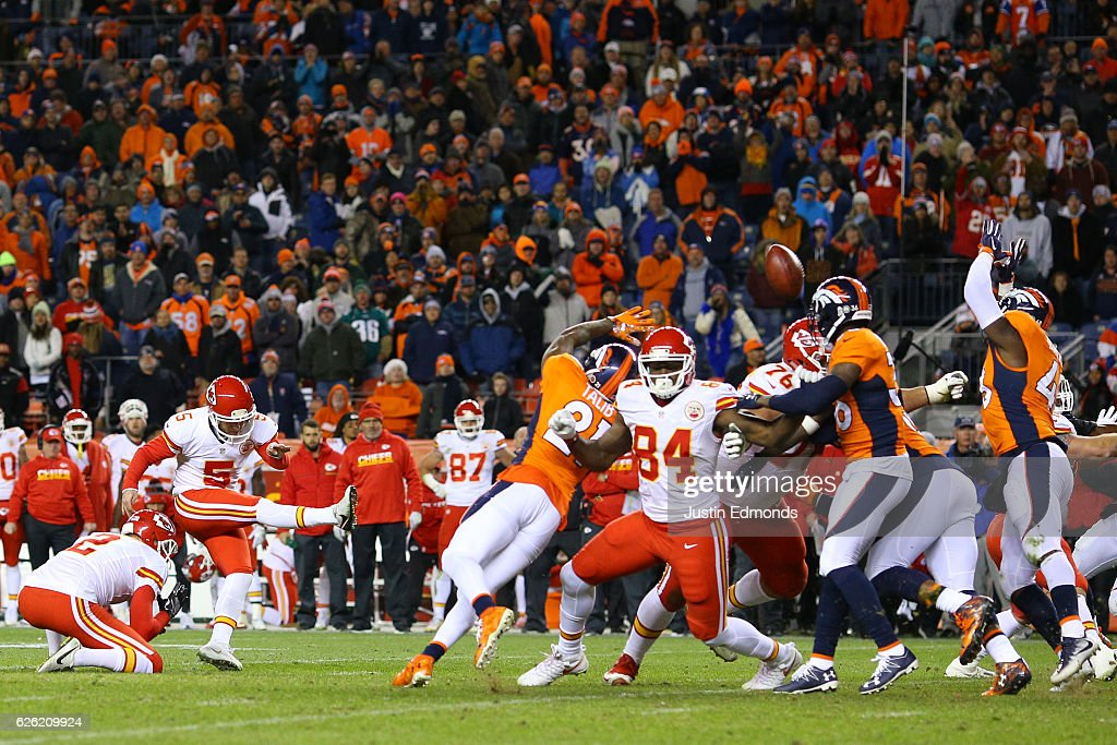 Kicker Cairo Santos #5 of the Kansas City Chiefs makes a game-winning field goal in overtime against the Denver Broncos at Sports Authority Field at Mile High on November 27, 2016 in Denver, Colorado.