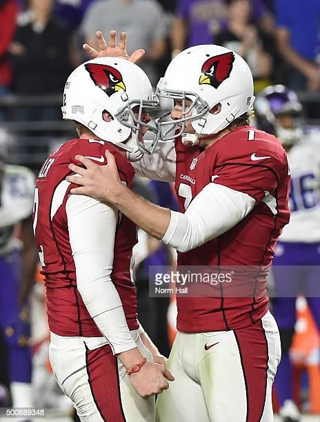 Kicker Chandler Catanzaro of the Arizona Cardinals celebrates with Drew Butler after Catanzaro kicked a 47 yard field goal against the Minnesota...