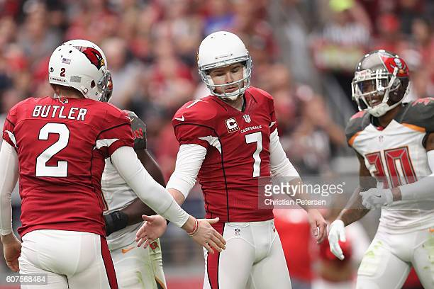 Kicker Chandler Catanzaro of the Arizona Cardinals high fives punter Drew Butler after kicking a 22 yard field goal against the Tampa Bay Buccaneers...