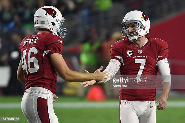 Kicker Chandler Catanzaro of the Arizona Cardinals is congratulate by long snapper Aaron Brewer after making a 46 yard field goal in the second...