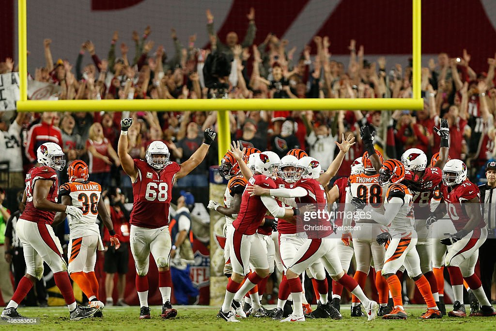 Kicker Chandler Catanzaro #7 of the Arizona Cardinals is congratulated by Drew Butler #2 and Mike Leach #82 after Catanzaro kicked the game winning field goal during the final moments of the NFL game against the Cincinnati Bengals at the University of Phoenix Stadium on November 22, 2015 in Glendale, Arizona. The Cardinals defeated the Bengals 34-31.