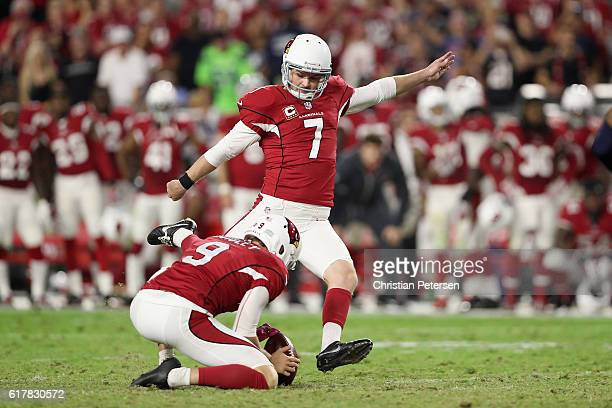 Kicker Chandler Catanzaro of the Arizona Cardinals kicks a 45 yard field goal against the Seattle Seahawks during overtime of the NFL game at the...