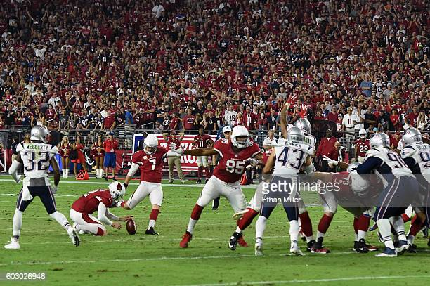 Kicker Chandler Catanzaro of the Arizona Cardinals misses a field goal attempt in the fourth quarter of the NFL game against the New England Patriots...
