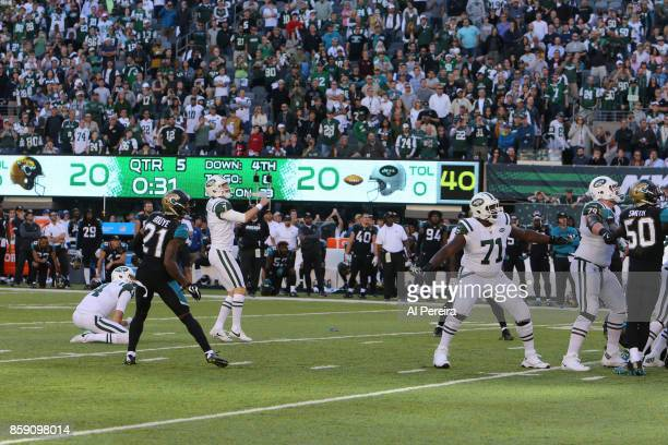 Kicker Chandler Catanzaro of the New York Jets kicks the game winning field goal in overtime against the Jacksonville Jaguars during their game at...