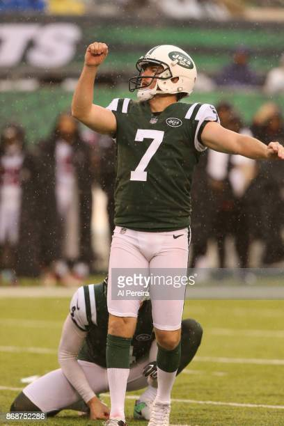 Kicker Chandler Catanzaro the New York Jets in action against the Atlanta Falcons in a heavy rain storm during their game at MetLife Stadium on...