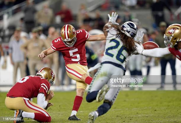Kicker Chase McLaughlin of the San Francisco 49ers kicks a 47 yard field goal to tie the game 2424 to end the fourth quarter taking the game in to...