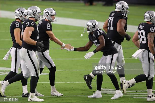 Kicker Daniel Carlson of the Las Vegas Raiders is congratulated by Nelson Agholor after kicking a 54yard field goal against the New Orleans Saints...