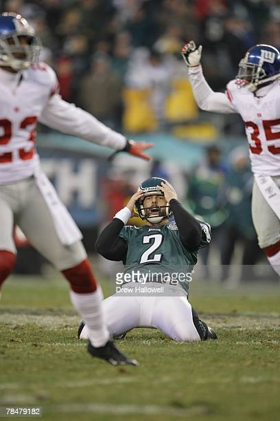 Kicker David Akers of the Philadelphia Eagles reacts to a missed last second field goal while cornerback Corey Webster and cornerback Kevin Dockery...