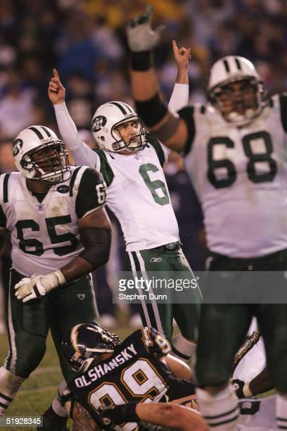 Kicker Doug Brien of the New York Jets celebrates after kicking the game winning field goal in overtime against the San Diego Chargers during the AFC...
