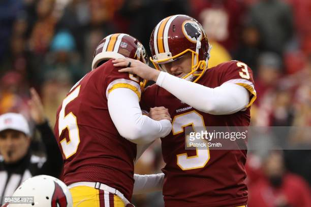 Kicker Dustin Hopkins and holder Tress Way of the Washington Redskins celebrate after a field goal in the fourth quarter against the Arizona...
