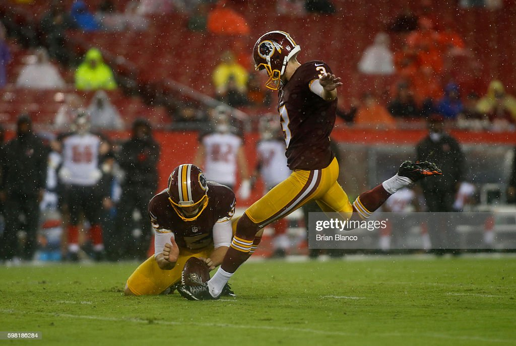 Kicker Dustin Hopkins #3 of the Washington Redskins gets a hold from punter Tress Way #5 as he kicks a field goal during the first quarter of an NFL game against the Tampa Bay Buccaneers on August 31, 2016 at Raymond James Stadium in Tampa, Florida.