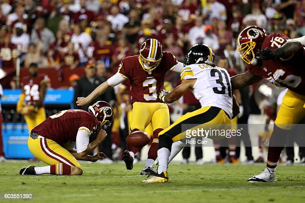 Kicker Dustin Hopkins of the Washington Redskins kicks a first quarter field goal against defensive back Ross Cockrell of the Pittsburgh Steelers at...