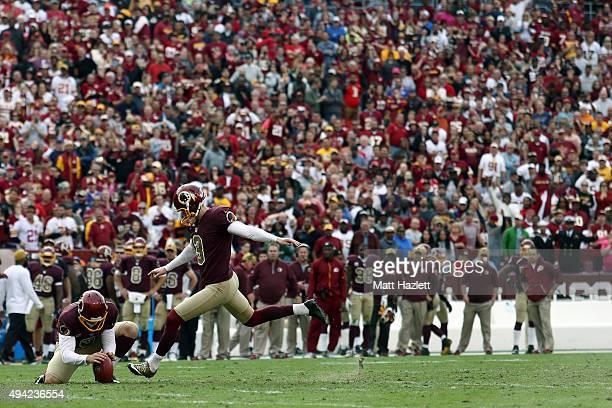 Kicker Dustin Hopkins of the Washington Redskins kicks a fourth quarter extra point to put the Washington Redskins ahead 3130 during a game against...