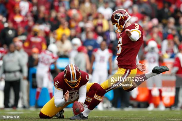 Kicker Dustin Hopkins of the Washington Redskins kicks an extra point in the first quarter against the Arizona Cardinals at FedEx Field on December...