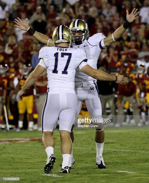 Kicker Erik Folk and holder Cody Bruns of the Washington Huskies celebrate after Folk's game winning field goal as time ran out in the game with the...