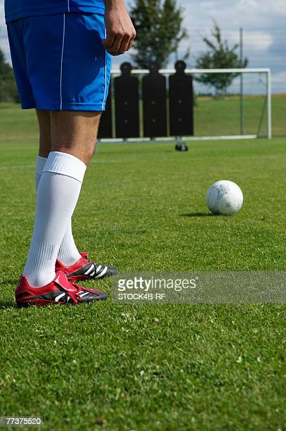 kicker exercising free kick - フリーキック ストックフォトと画像