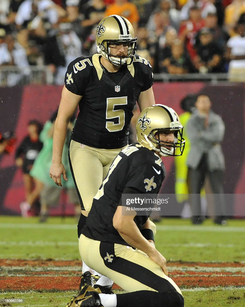 Kicker Garrett Harley #5 of the New Orleans Saints sets for a 3rd-quarter field goal attempt against the Tampa Bay Buccaneers September 15, 2013 at Raymond James Stadium in Tampa, Florida. The Saints won 16 - 14.