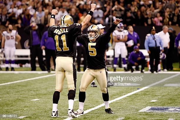 Kicker Garrett Hartley and holder Mark Brunell of the New Orleans Saints celebrate after Hartley kicked a 40yard gamewinning field goal in overtime...