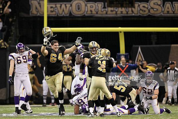 Kicker Garrett Hartley of the New Orleans Saints celebrates with teammates David Thomas Zach Strief and Mark Brunell after kicking a 40yard...