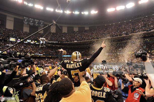 Kicker Garrett Hartley of the New Orleans Saints is mobbed by teammates after hitting a gaming winning field goal in overtime against the Minnesota...