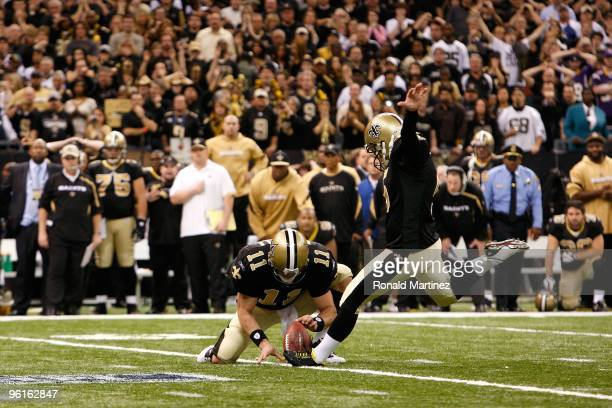 Kicker Garrett Hartley of the New Orleans Saints successfully kicks a 40yard gamewinning field goal in overtime from the hold of Mark Brunell against...