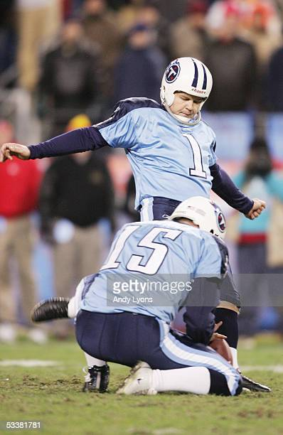 Kicker Gary Anderson of the Tennessee Titans attempts to score off a hold by punter Craid Hentrich during the game against against the Kansas City...