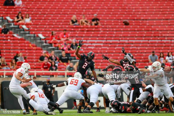 Kicker Gino Garcia of the Houston Baptist Huskies kicks a field goal against the Texas Tech Red Raiders during the first half of the college football...