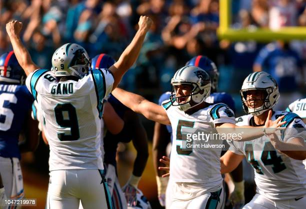 Kicker Graham Gano celebrates with Michael Palardy and JJ Jansen of the Carolina Panthers after his gamewining 63yard field goal against the New York...