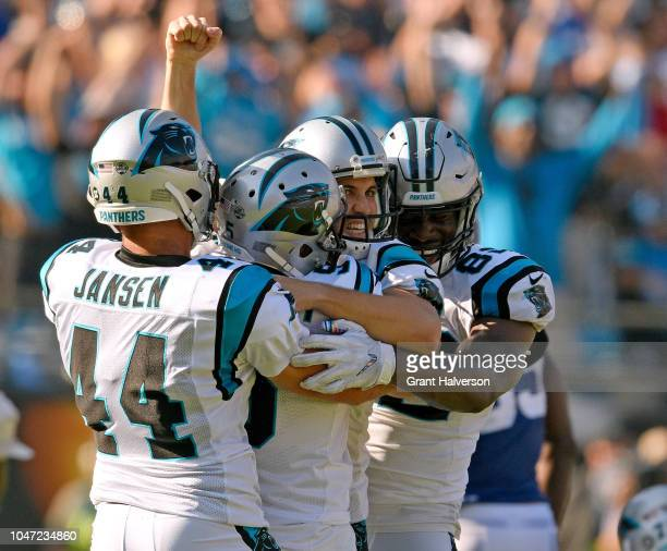 Kicker Graham Gano celebrates with Michael Palardy JJ Jansen and Chris Manhertz of the Carolina Panthers after his gamewining 63yard field goal...