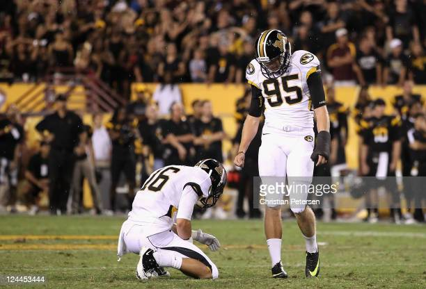 Kicker Grant Ressel and Ashton Glaser of the Missouri Tigers react after missing the possible game winning field goal in the final seconds of...