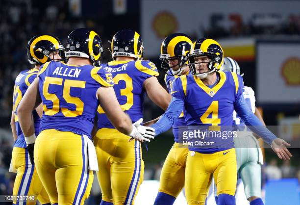 Kicker Greg Zuerlein of the Los Angeles Rams celebrates his field goal in the first quarter against the Dallas Cowboys in the NFC Divisional Round...
