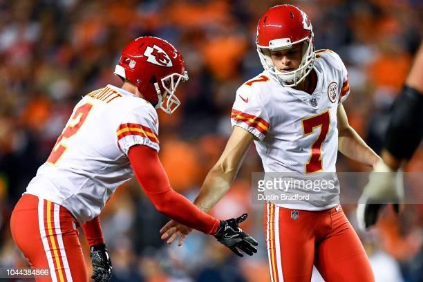Kicker Harrison Butker and punter Dustin Colquitt of the Kansas City Chiefs celebrate a third quarter field goal against the Denver Broncos at...