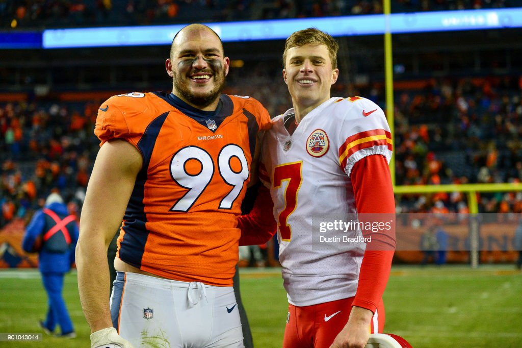 Kicker Harrison Butker #7 of the Kansas City Chiefs and defensive end Adam Gotsis #99 of the Denver Broncos, who played together at Georgia Tech, stand for a photo after a game at Sports Authority Field at Mile High on December 31, 2017 in Denver, Colorado.
