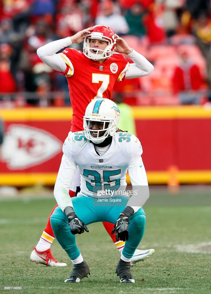 Kicker Harrison Butker #7 of the Kansas City Chiefs and free safety Walt Aikens #35 of the Miami Dolphins both react as they watch a long field goal go through the goalposts during the game at Arrowhead Stadium on December 24, 2017 in Kansas City, Missouri.