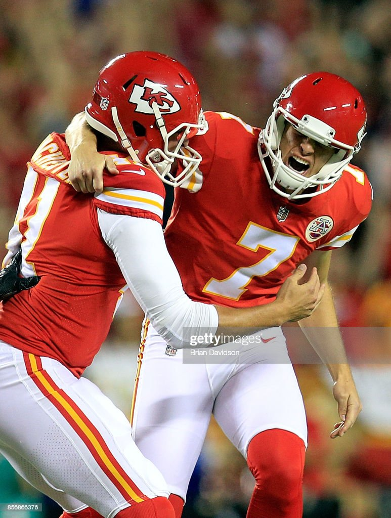 Kicker Harrison Butker #7 of the Kansas City Chiefs celebrates with long snapper James Winchester #41 after kicking the go-ahead field goal with 8 seconds remaining during the 4th quarter of the game against the Washington Redskins at Arrowhead Stadium on October 2, 2017 in Kansas City, Missouri.