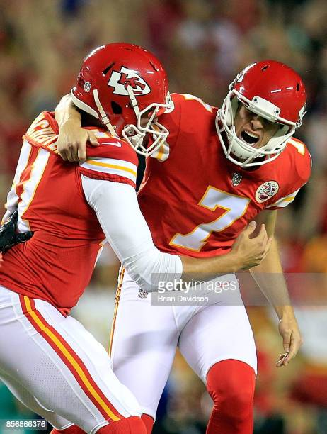 Kicker Harrison Butker of the Kansas City Chiefs celebrates with long snapper James Winchester after kicking the goahead field goal with 8 seconds...