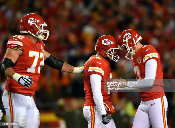 Kicker Harrison Butker of the Kansas City Chiefs is congratulaed by punter Dustin Colquitt and offensive tackle Eric Fisher after making a field goal...