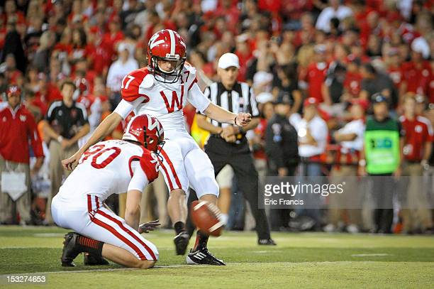 Kicker Jack Russell of the Wisconsin Badgers boots an extra point against the Nebraska Cornhuskers during their game at Memorial Stadium on September...