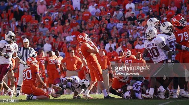 Kicker Jad Dean the Clemson Tigers watches his game-tying field goal go wide during the final seconds of his team's loss to the South Carolina...