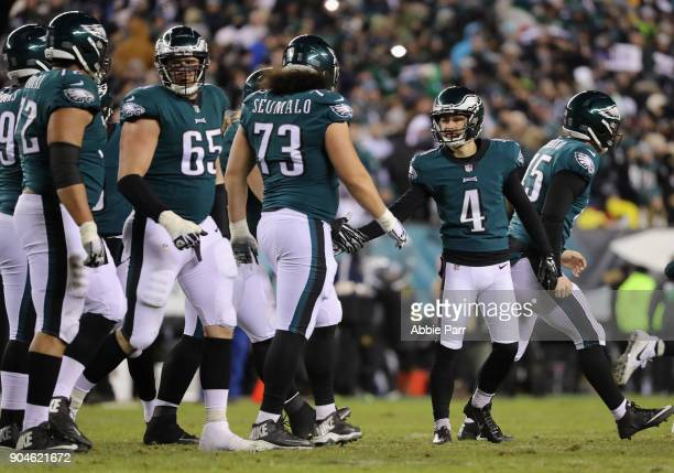 Kicker Jake Elliott of the Philadelphia Eagles celebrates his 21yard field goal with teammates against the Atlanta Falcons during the third quarter...