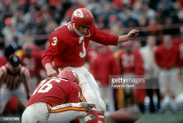 Kicker Jan Stenerud of the Kansas City Chiefs kicks a field goal with quarterback Len Dawson holding during an NFL football game circa 1969 at...