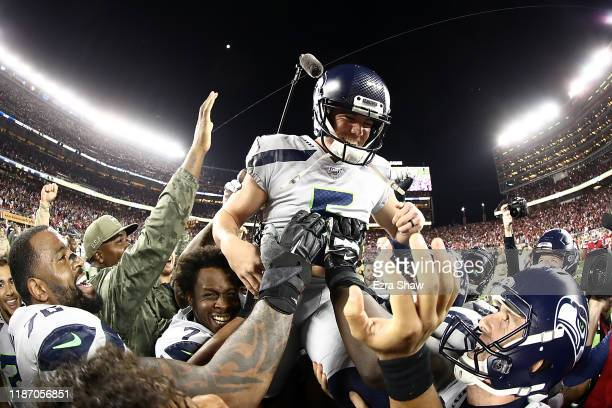 Kicker Jason Myers of the Seattle Seahawks is carried off the field after making the winning 42 yard field goal in overtime to win 27-24 over the San...