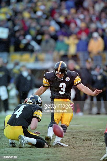 Kicker Jeff Reed of the Pittsburgh Steelers kicks on a hold by Josh Miller during a game against the Cincinnati Bengals at Heinz Field on November 24...