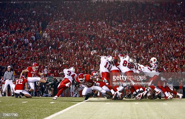 Kicker Jeremy Ito of the Rutgers Scarlet Knights kicks the game winning field goal against the Louisville Cardinals at Rutgers Stadium on November 9...