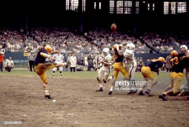 Kicker Jim Brown of the Illinois Fighting Illini punts the ball during an NCAA game against the Penn State Nittany Lions on October 24, 1959 at...