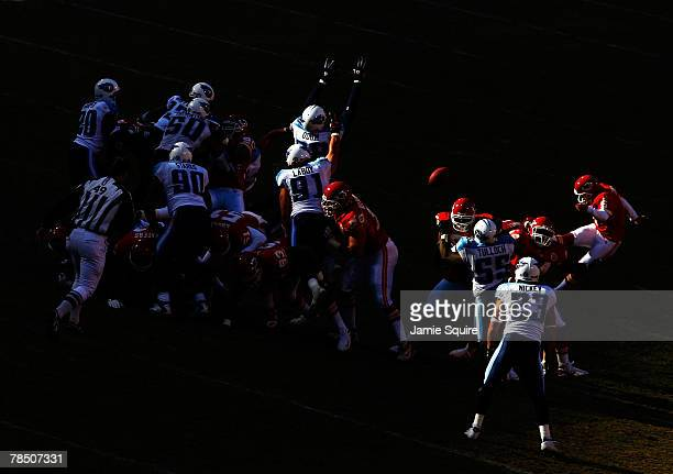 Kicker John Carney of the Kansas City Chiefs kicks a field goal as Antwan Odom of the Tennessee Titans tries to block during the game on December 16...