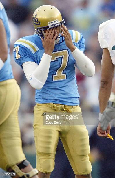 Kicker Justin Medlock of the UCLA Bruins reacts after missing a short field goal against the Oregon Ducks on November 15 2003 at the Rose Bowl in...